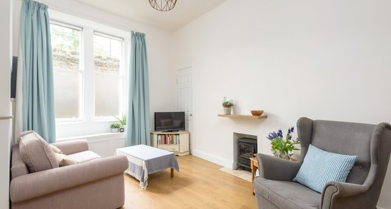 Waverley Park No.1 1 - Open plan living area with traditional polished floorboards