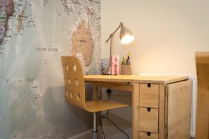Wooden desk and chair, huge map on the wall