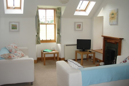 Sel catering, Lodge cottage, sitting room overlooking goose Green in Gullane
