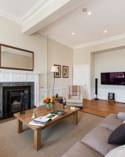 Living Room - Featuring flat screen TV and music facilities. (© The Edinburgh Address)
