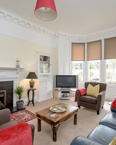 Lauderdale Street 2 - Large family living room with hand picked furnishings and Victorian bay windows