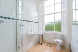 White bathroom with shower in Edinburgh apartment