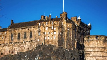 Edinburgh Castle against a blue sky