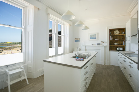 Open plan kitchen with sea views