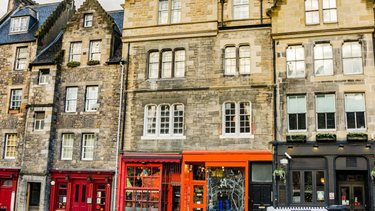 Row of colourful pubs and shops in Edinburgh Grassmarket