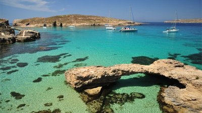 Crystal blue Gozo waters - Holidays to Gozo are ideal for swimming, diving, snorkelling, kayaking, sailing and much more in the blue Mediterranean waters.
