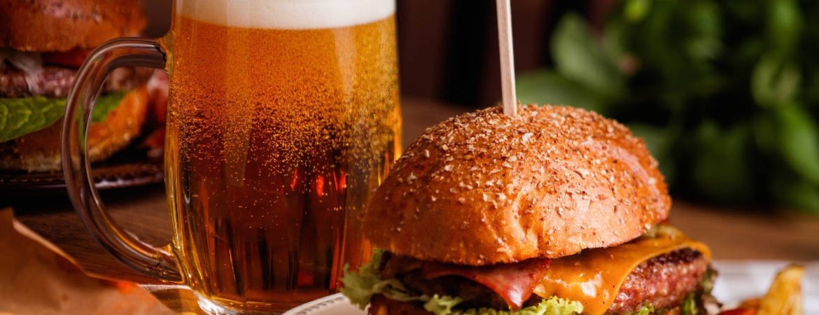 A beer and burger meal in a pub