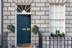 Albany Street Townhouse Front Door - Georgian Townhouse Exterior with dark blue front door, stone work and black railings.