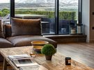 Living Room to Terrace - The living room centers around the feature coffee table. What was once a door in Italy is now a breathtaking tabletop. (© The Edinburgh Address)