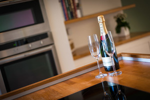 Albany Street Townhouse Drinks - A bottle of champagne and 2 glasses on kitchen worktop