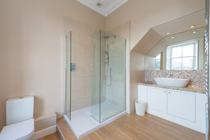 Bathroom with glass walk-in shower.