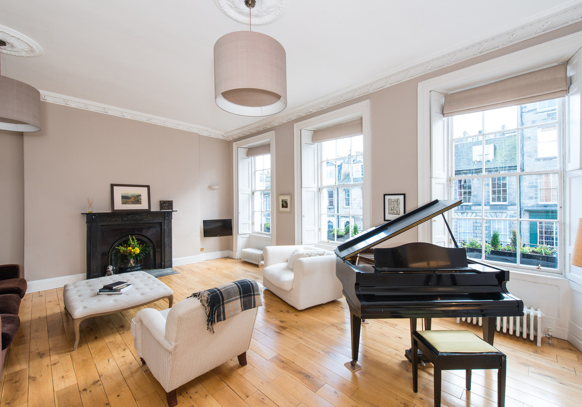 Albany Street Townhouse Drawing Room - Elegant drawing room in Edinburgh Townhouse with white furniture and a dark fireplace and grand piano