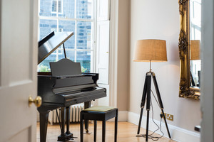 Grand piano in Albany Street - To add to the sense of luxury, this self catering holiday property in Edinburgh boasts a beautiful piano in the drawing room.