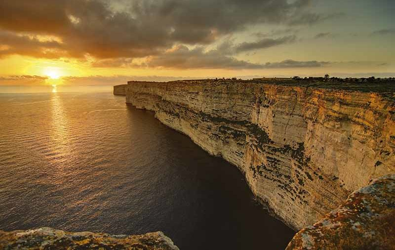 """Clifftop View of Gozo Sunset"""