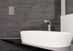 The luxurious bathroom has a stand alone bathtub as well as a shower