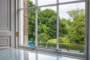 Large window overlooking garden.