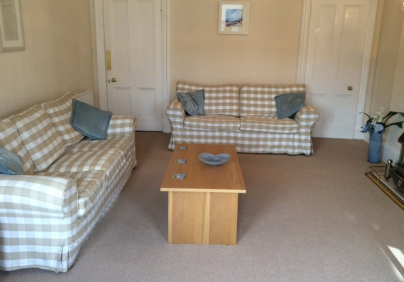 Spacious 2 bedroom holiday apartment in North Berwick just across from the beach - Sitting room with a sea view from the corner window (© Coast Properties)