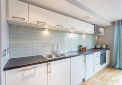 KITCHEN WITH FEATURE TILED SPLASHBACK WALL