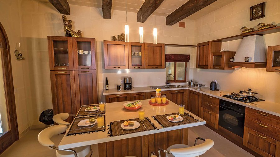 Gladjola's family kitchen - A typical farmhouse kitchen with traditional wooden oak beams that continue throughout this holiday home.