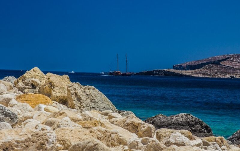 Marsalforn - Holidays to Gozo are great for a tranquil sail on the sea and for exploring the island caves.