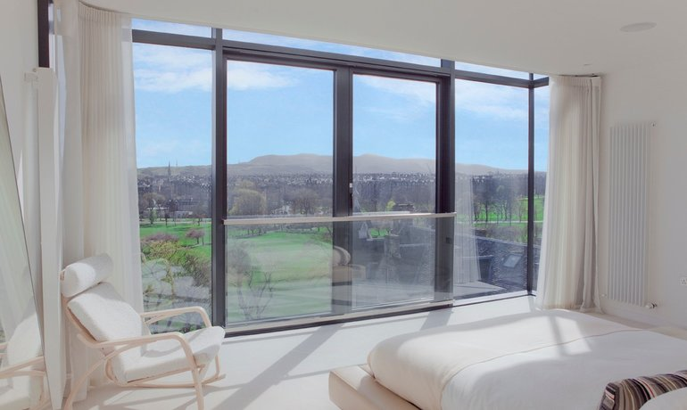 Master Bedroom - Floor to ceiling windows provide breathtaking views of the Pentland Hills. (© The Edinburgh Address)
