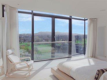 Master Bedroom - Floor to ceiling windows provide breathtaking views of the Pentland Hills. (© The Edinburgh Address)