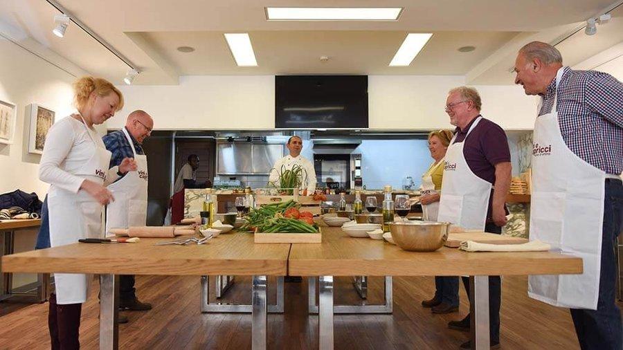 Preparing food at Vini E Capricci