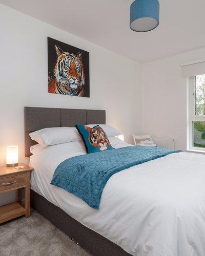 Cruickshank Gardens 3 - Master bedroom with striking tiger wall painting