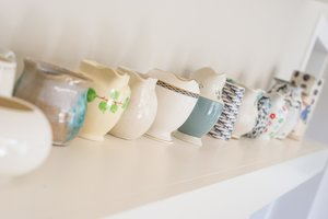 Collection of jugs displayed along a shelf