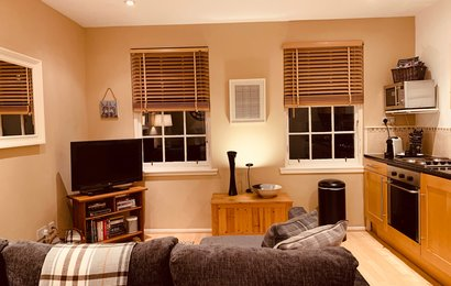 image00018 - Charming open plan living room and kitchen area.