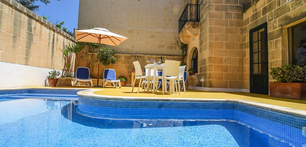 1. Outdoor area with private pool and BBQ