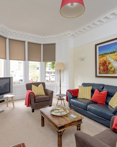 Lauderdale Street 3 - Large family living room with hand picked furnishings and Victorian bay windows