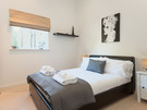 Belmont Apartment Master bed - Master bedroom includes en-suite shower room