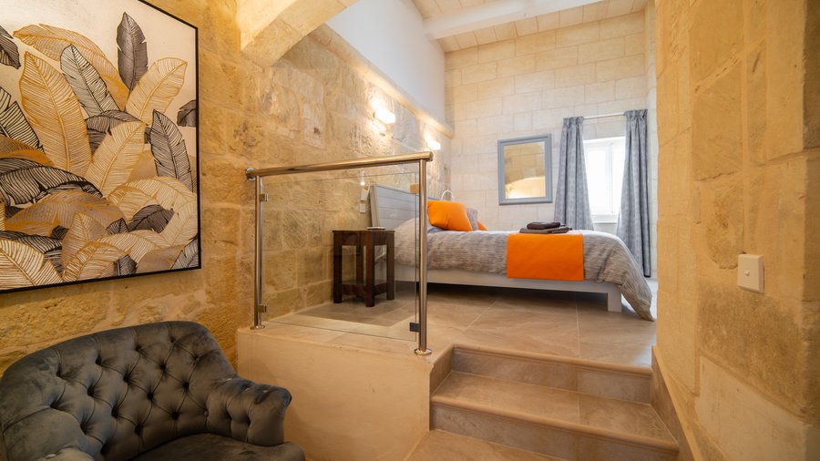 Master Bedroom - A great example of an old traditional Gozo Farmhouse fully restored with a modern finish.