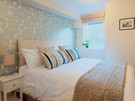 Drummond Street 8 - Double bedroom with decorative feature wall in Edinburgh holiday let