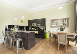 The fully equipped kitchen with dining area