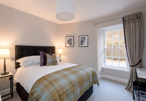 Stafford Street Apartment Master Bedroom - Master Bedroom with kingsize bed and tartan throw in Edinburgh West End Apartment.