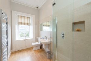 Bathroom with walk-in shower, sink, towel rail ...