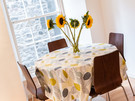 Edmonstone's Close (Grassmarket) 5 - Family dining table with with leaf patterned table cloth in Edinburgh holiday let