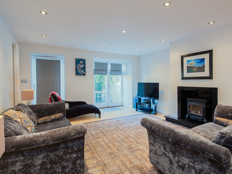 York Place Residence-23 - Spacious family living area with wood burning stove