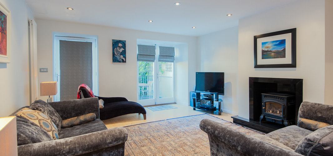 York Place Apartment-23 - Spacious family living area with wood burning stove