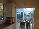 Kitchen and Dining - View of the dining conservatory that opens out on to the large sunny enclosed rear garden.