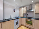Patriothall 5 - Family kitchen with ample cupboard space in Edinburgh holiday let