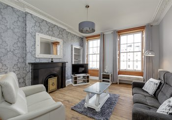 St Patrick Square 1 - Large family living room with a traditional fireplace