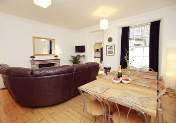 Living Room and Dining Area - Beautiful spacious and sociable living room with open plan kitchen adjoined at the rear.