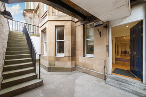 Basement entrance to Edinburgh apartment with front door open.