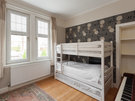 Traquair Park West 8 - Twin room with bunk beds and piano