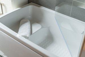 Deep compact bath within West End holiday apartment Edinburgh
