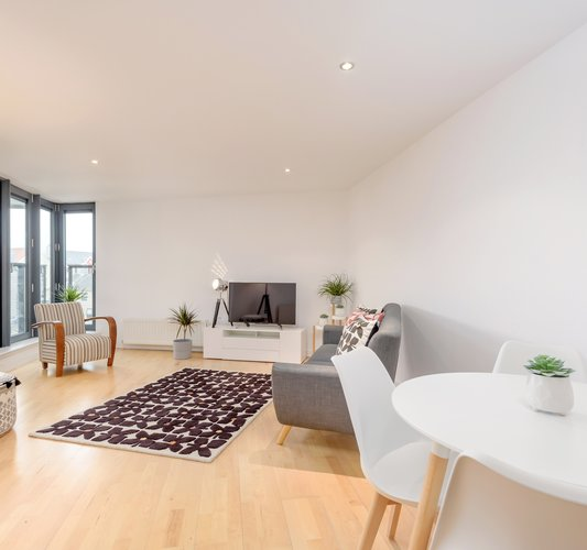 Sandport Way 2 - Spacious, contemporary open plan living room / dining area, featuring floor to ceiling windows in Edinburgh holiday apartment.