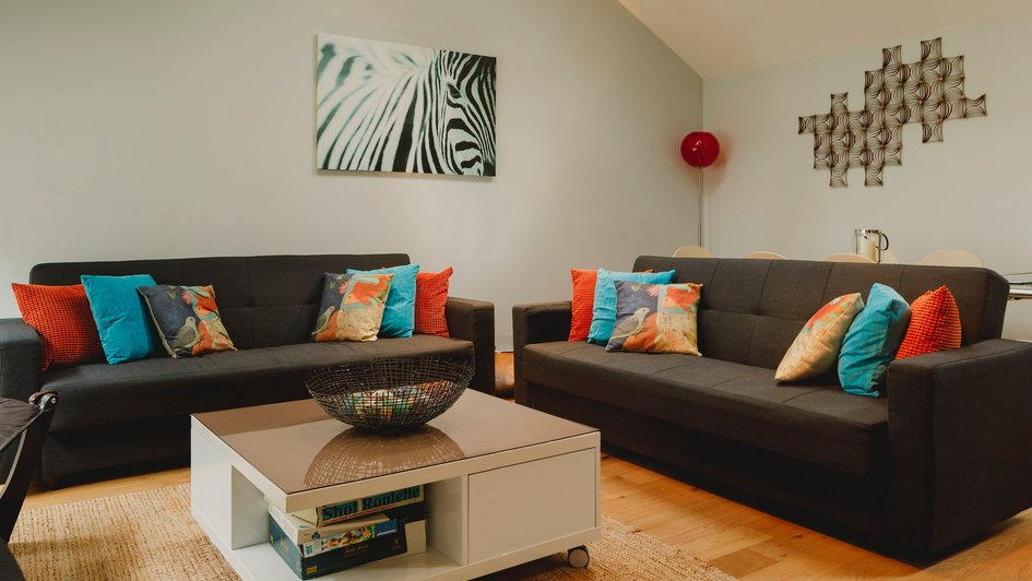 Living room with sofa beds - Social space which converts to an extra sleeping area at night